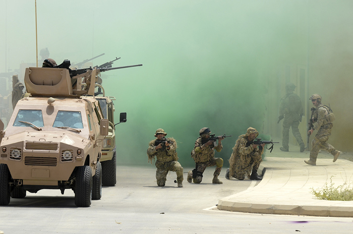 Coalition service members with Combined Joint Task Force Spartan provide security for their teams during a capabilities demonstration for King Abdullah II of Jordan May 16, 2012, as part of exercise Eager Lion 2012 at the King Abdullah II Special Operations Training Center in Amman, Jordan. Eager Lion is a U.S. Central Command-directed, irregular warfare-themed exercise focusing on missions the United States and its coalition partners might perform in support of global contingency operations. (DoD photo by Spc. Samantha Parks, U.S. Army photo/Released)
